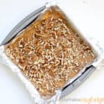 pumpkin fudge with pecans in baking pan
