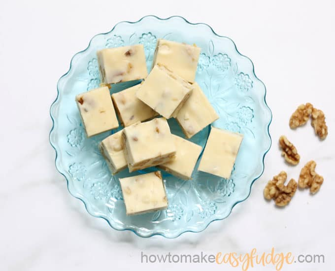 maple walnut fudge on blue plate overhead shot