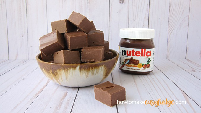 bowl of Nutella fudge sitting next to a jar of Nutella