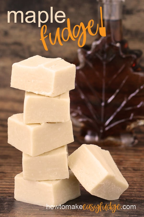 "squares of creamy maple fudge stacked up in front of a maple leaf shaped bottle of maple syrup on a deep brown background with the text ""maple fudge"""