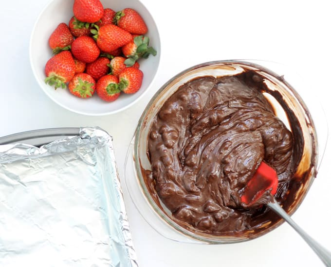 melted chocolate and preparing chocolate covered strawberry fudge