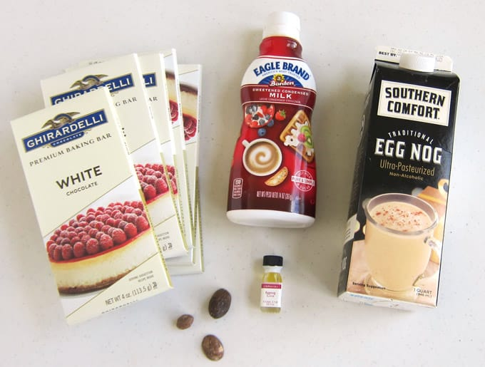 easy eggnog fudge ingredients: Ghirardelli White Chocolate Bars, Eagle Brand Sweetened Condensed Milk, Southern Comfort Egg Nog, nutmeg, and LorAnn Oils Eggnog Flavoring