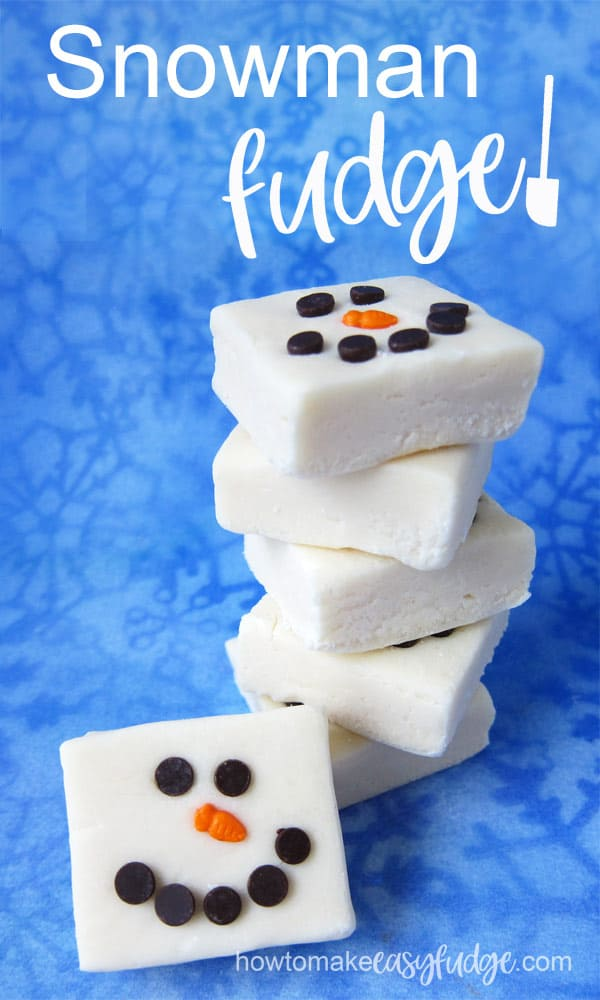 A square of white snowman fudge is set in front of a stack of 5 pieces of the same fudge snowmen on a blue snowflake background.