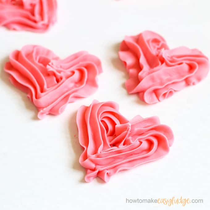2-ingredient pink fudge hearts close up on white background