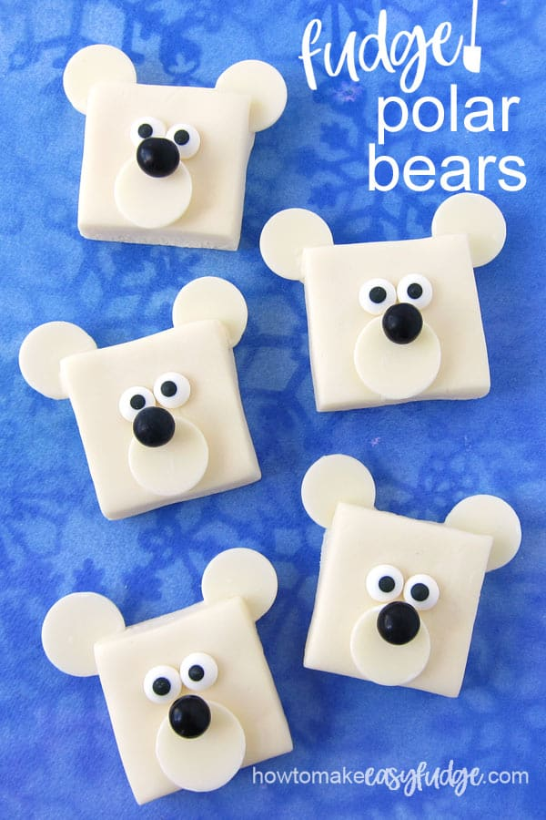 white chocolate fudge polar bears are decorated using white candy melts, black chocolate candies and royal icing eyes
