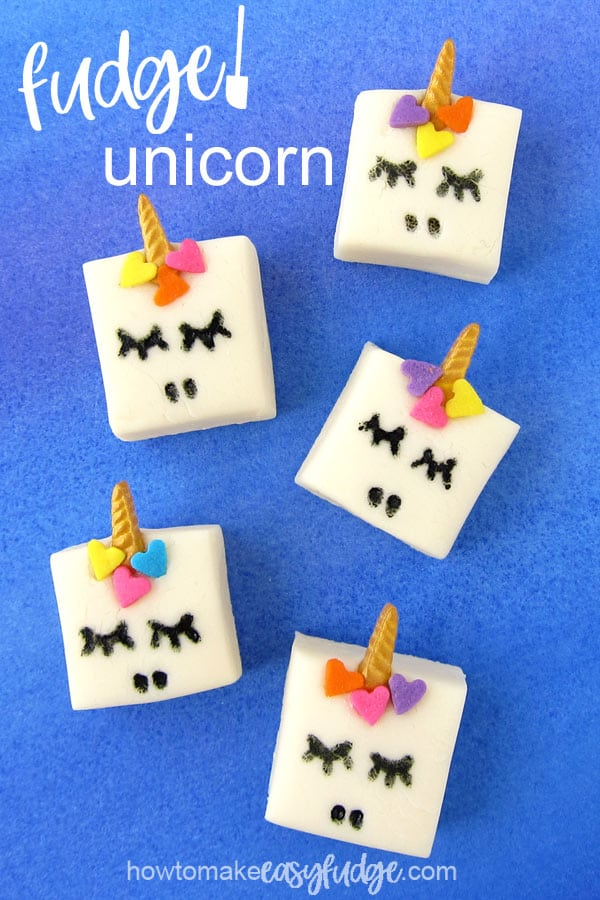 White chocolate fudge decorated to look like unicorns using gold unicorn horn sprinkles and heart sprinkles.