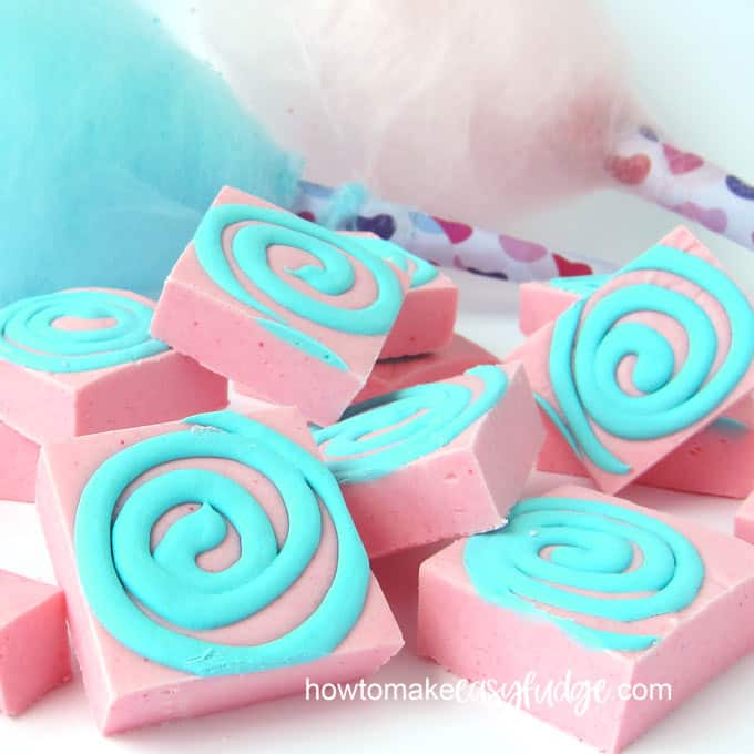 Pastel pin cotton candy fudge is topped with a fun swirl of blue colored cotton candy fudge.