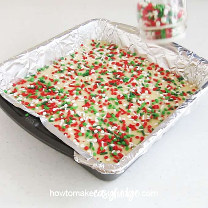 Top vanilla fudge with Christmas sprinkles to make this festive holiday fudge.