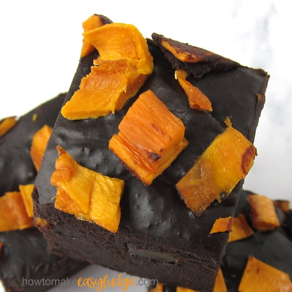 Square of mango fudge topped with bits of dried mangos.