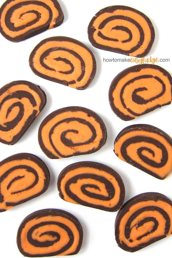 Slices of swirled orange and dark chocolate fudge.