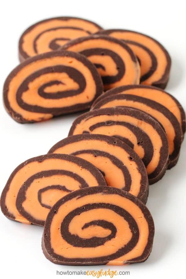 Chocolate and orange fudge are swirled together into fudge pinwheels for Halloween.