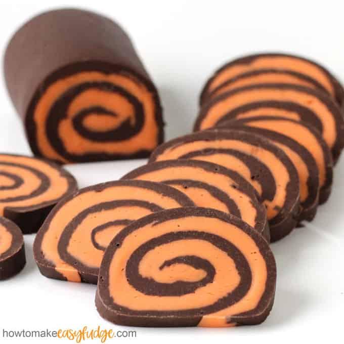 Layers of chocolate and orange fudge are swirled together to create pinwheels.