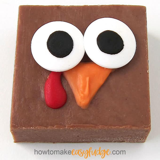 square milk chocolate fudge decorated with candy eyes, orange candy melts beak, and red candy melts wattle to create a cute turkey