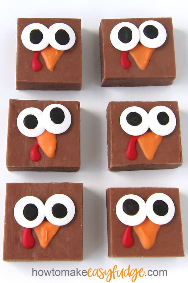 milk chocolate fudge turkeys with candy eyes and an orange beak and red wattle