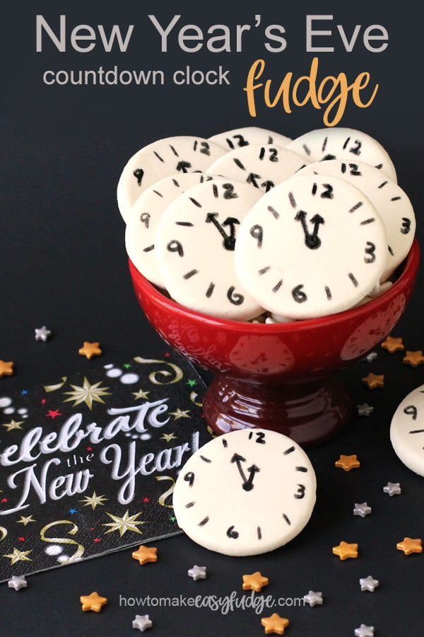 """New Year's Eve Fudge Countdown Clocks arranged in a bowl next to a """"celebrate the new year"""" napkins."""